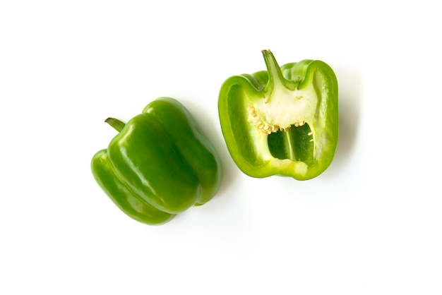 Close up chopped and slice green bell peppers isolated on white background Premium Photo