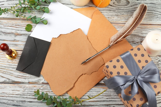Close up of christmas letter writing on yellow paper on wooden background with decorations Premium Photo