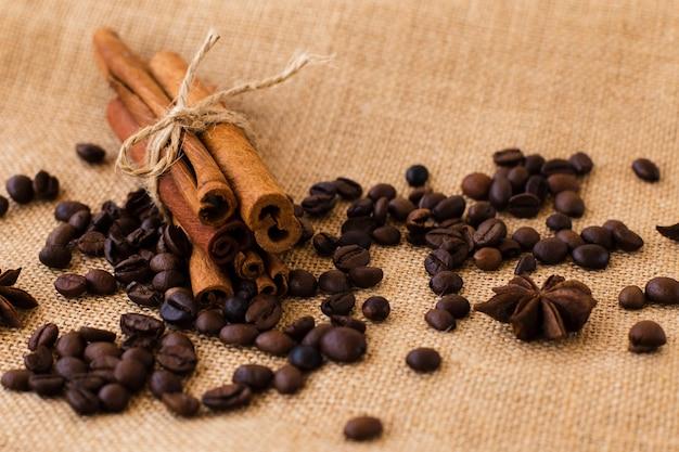 Close-up cinnamon sticks with coffee beans Free Photo
