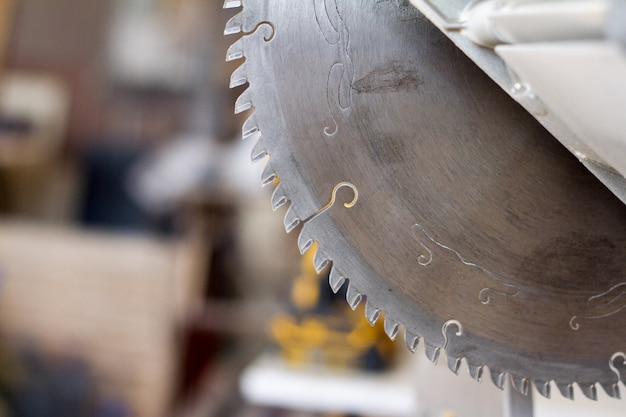 Close-up circular saw on a carpentry workshop Premium Photo