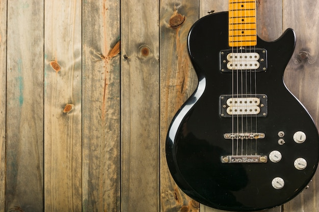 Close-up of classic electric guitar on wooden table Free Photo