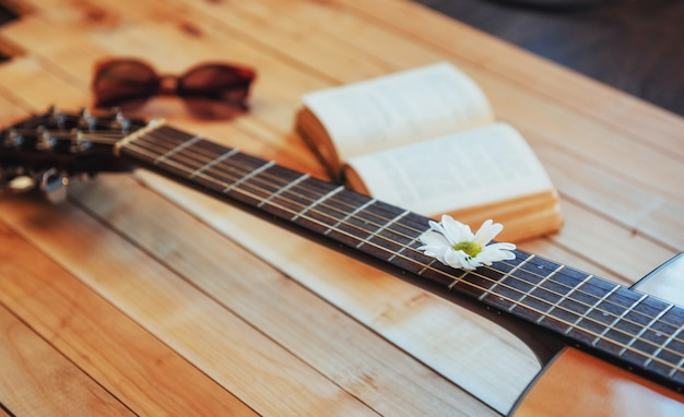 Close up classical guitar head with glasses and book Premium Photo
