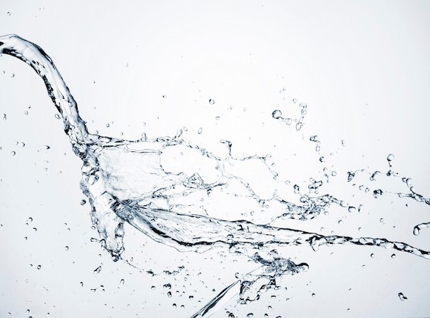 Close-up clear water dynamic on light background Free Photo