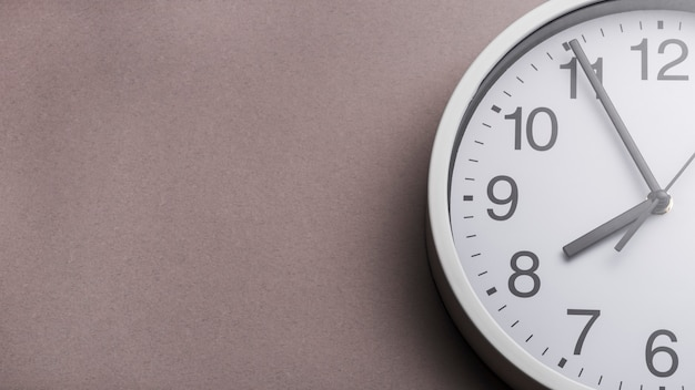 Close-up of clock face against gray background Premium Photo