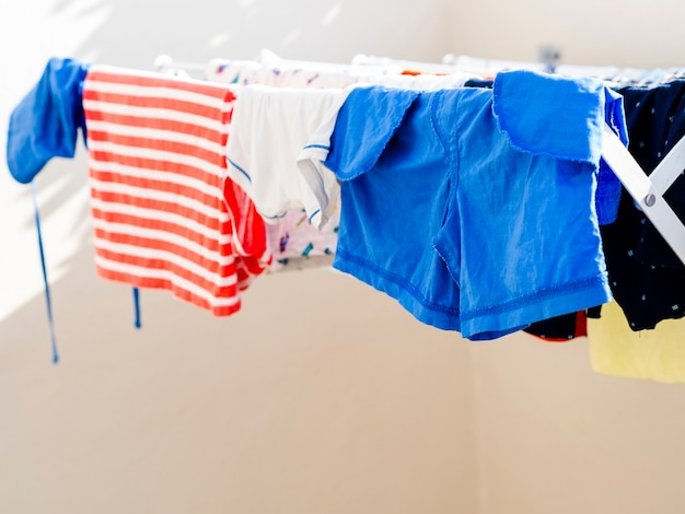 Close-up clothes drying on the line Free Photo