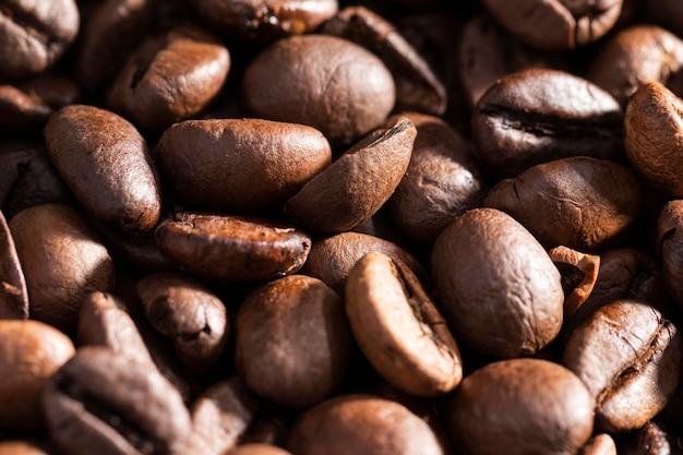 Priorità bassa organica dei chicchi di caffè del primo piano Foto Gratuite