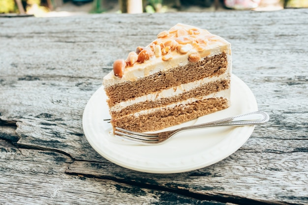 Close up coffee cake on wooden table background Premium Photo