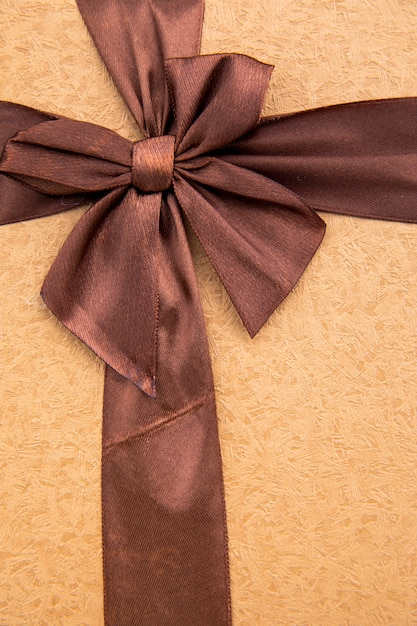 Close up coffee coloured ribbon with bow Free Photo
