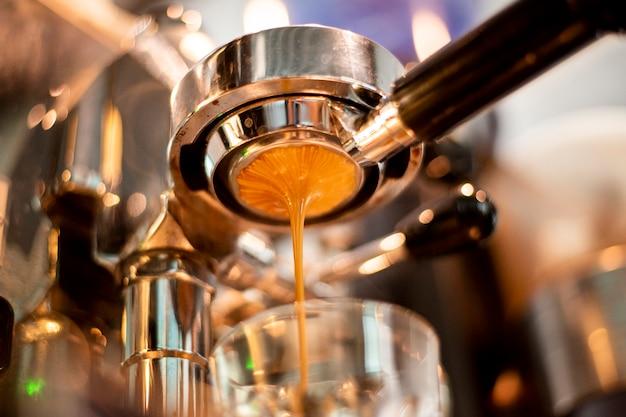 Close up of coffee machine is preparing coffee in coffee shop Premium Photo