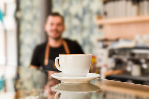 Close-up of coffee on reflective glass counter in caf� Free Photo