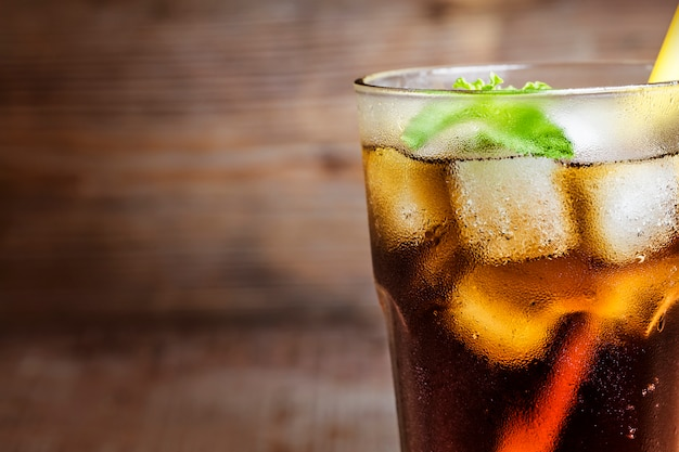 Close-up of cola with a straw Free Photo
