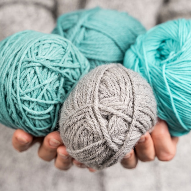 Close-up of colored wool yarn balls Photo | Free Download