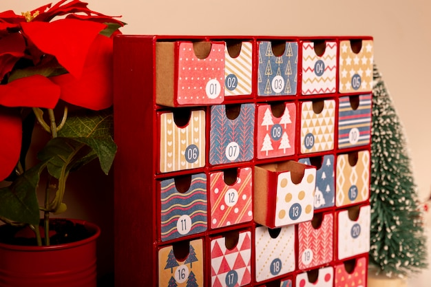 Close-up colorful advent calendar on table Free Photo