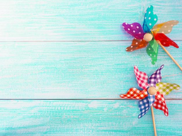 Close up colorful pinwheel over blue wood background Premium Photo