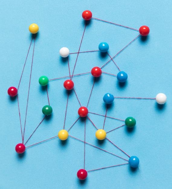 Close-up colourful pushpin map Free Photo