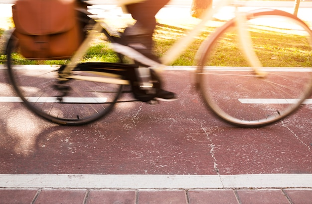 Close-up of a commuter riding the bicycle Free Photo