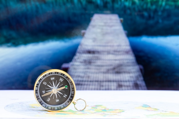 Close up compass on paper map, travel and lifestyle, manage to success business technology concept. Premium Photo