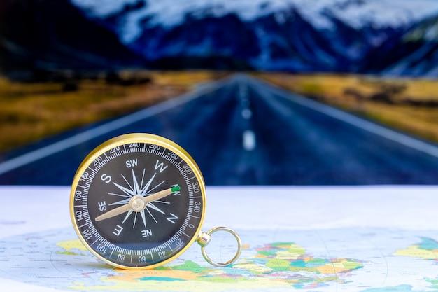 Close up compass on paper map Premium Photo