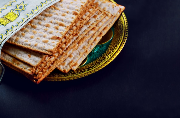 Close up of concept jewish holiday passover matzot and tallit the substitute for bread on the jewish passover holiday. Premium Photo