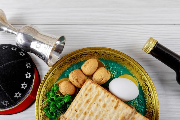 Close up of concept jewish holiday passover matzot and tallit the substitute Premium Photo