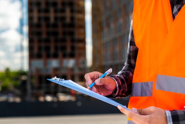 Close-up construction engineer writing Free Photo