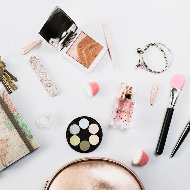 Close-up cosmetics near cute makeup bag Free Photo