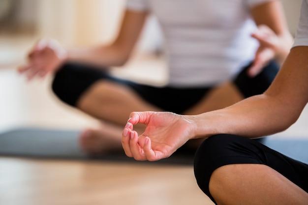 Close-up couple exercising yoga Free Photo