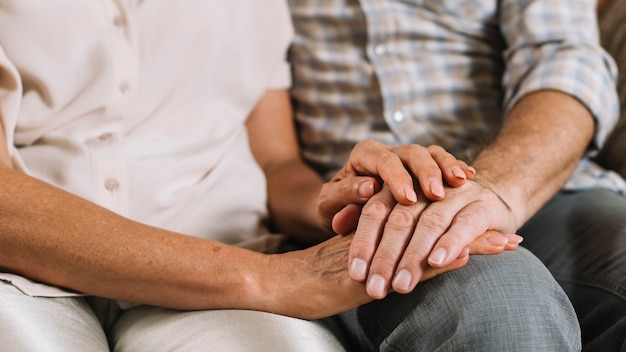 Close-up of couple holding each other's hand Premium Photo