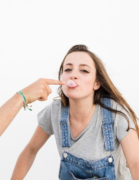 Close-up of couple playing with bubble gum Free Photo