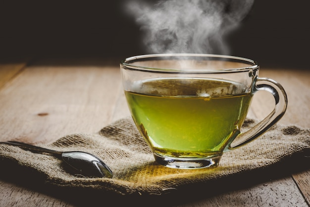 Close-up a cup of green tea on sackcloth Premium Photo