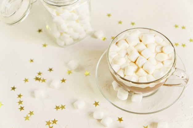 Close up of cup of hot delicious cocoa drink with marshmallows. Premium Photo