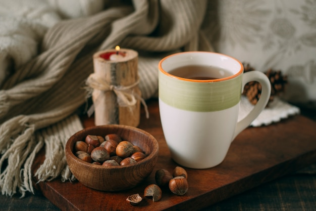 Close-up cup of tea with acorns Free Photo