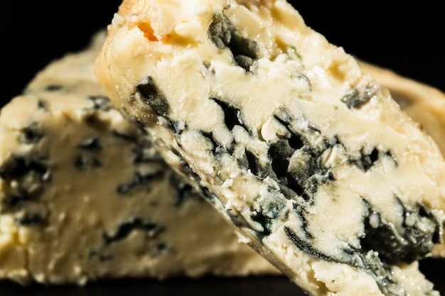 Close-up of cut blue cheese with mould inside Free Photo