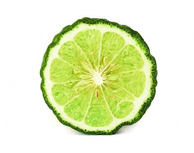 Close up a cut half of bergamot fruit and leaf on white background Premium Photo