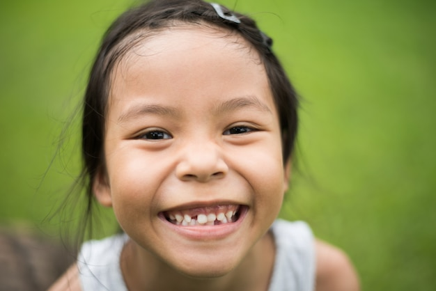 8bdbf1b2b099 Close up of cute little girl's face with a smile looking at the camera. Free
