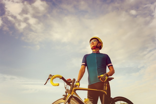 Close up cyclist male standing with road bike sunset sportsman race concept 29315 71