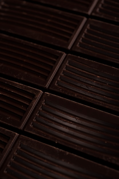 Close up of dark chocolate bar tiles Free Photo