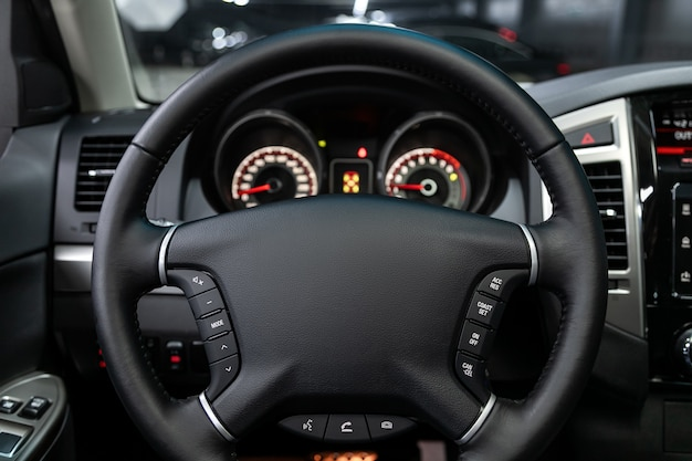 Close-up of the dashboard, speedometer, tachometer and steering wheel. . modern car interior Premium Photo