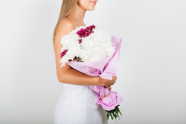 Close-up delicate woman hands holding bunch of flowers Free Photo