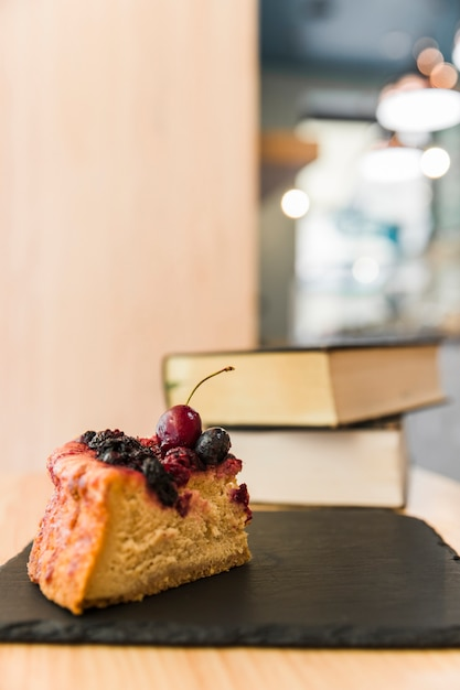 Close-up of delicious berry pastry on shale board Free Photo