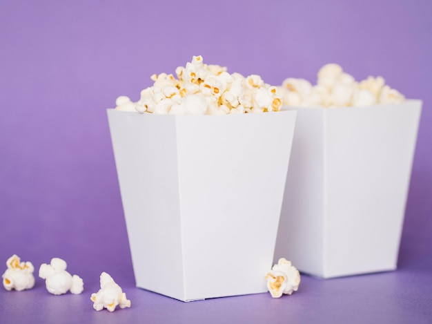Close-up delicious popcorn boxes on the table Premium Photo