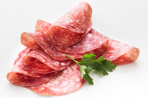 Close-up delicious salami with parsley Free Photo