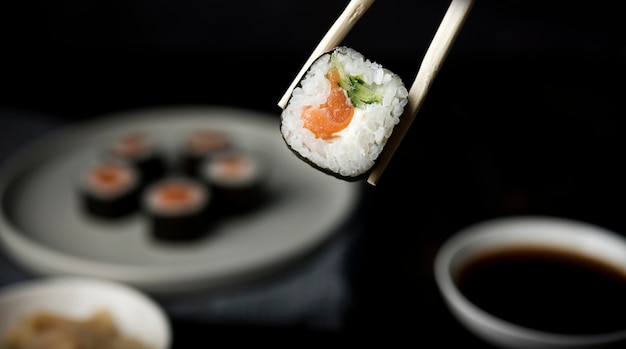 Close-up delicious sushi roll with veggies and rice Free Photo