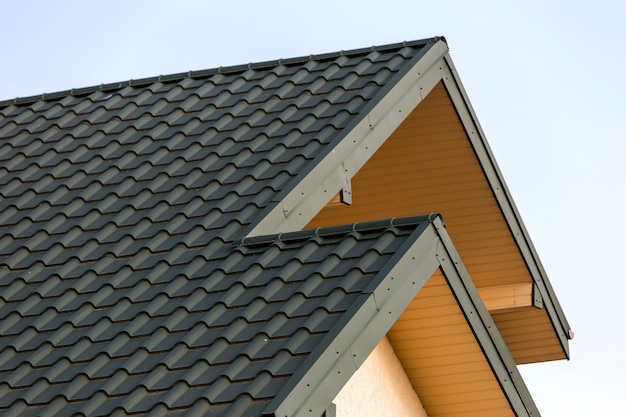 Close-up detail of new modern house top with shingled green roof Premium Photo