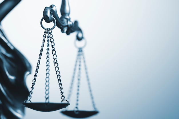 Close up detail of the scales of justice Premium Photo