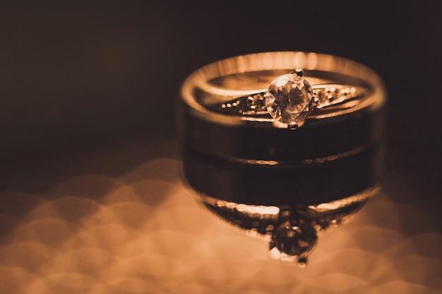 Close up of diamond wedding rings with selective focus Premium Photo