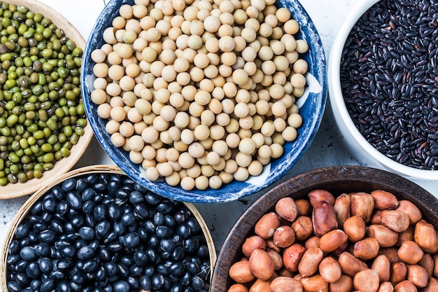 Close-up of different legumes in bowls Free Photo