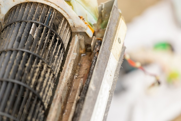 Close up of dirty inside compartments air conditioner Premium Photo