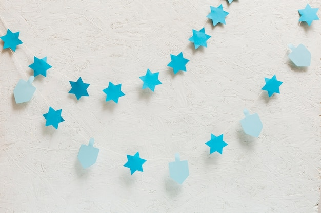 Close-up dreidel and stars collection Free Photo