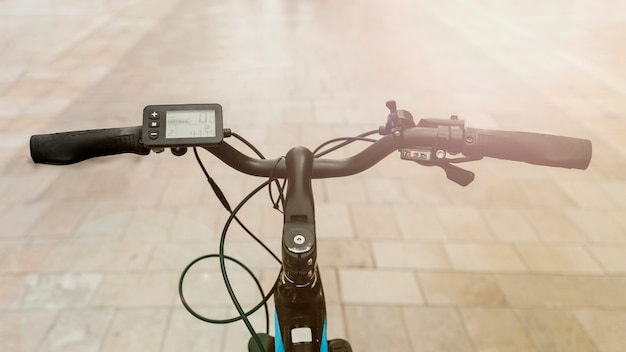 Close up e-bike on street with sunflare Free Photo